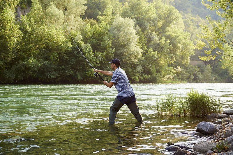 fisherman in stream