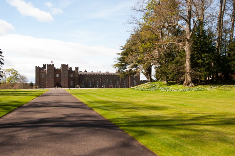 Perthshire, Scotland - May 5, 2013: Tourists walk the grounds around Scone Palace in Perthshire on a sunny spring day as tourism season ramps up.