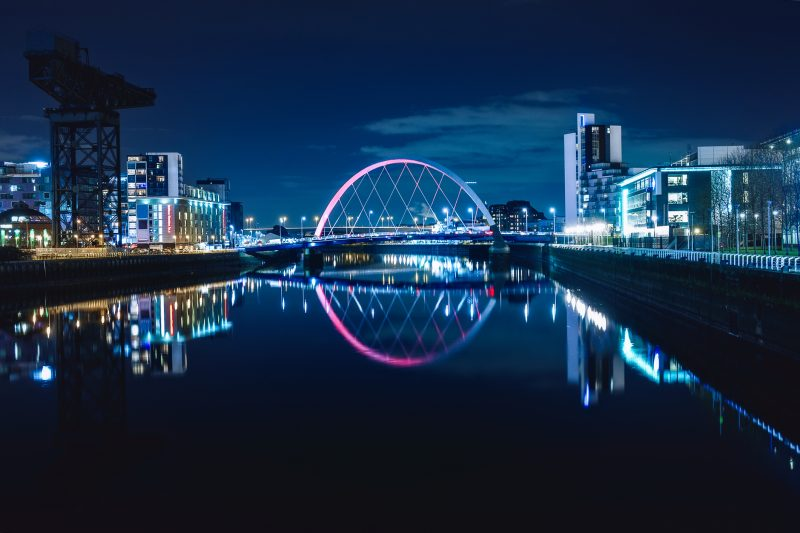 Night view of the Clyde Arc or Squinty Bridge from the East and river Clyde, Glasgow, Scotland